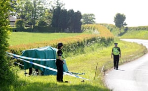 Whitehaven shootings: A crashed car on its side on the quiet country lane into Seascale