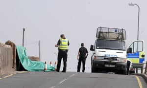 Whitehaven shootings: A  tarpaulin cover marks the site of yet another victim in Seascale