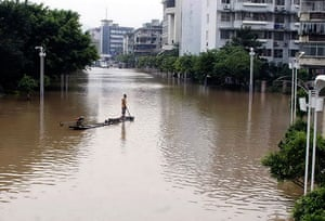 Chian flooding: A man watch from his raft over a flooded neighborhood in downtown Guilin