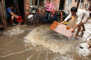 Chian flooding: People drain the street in a residential community  in Nanning