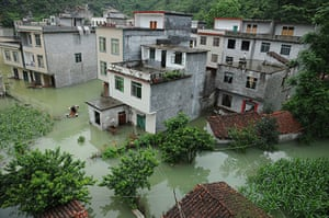 Chian flooding: Water floods houses of Laping Village in Donglan