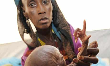 A woman with malnourished baby at an intensive nutritional rehabilitation centre in southern Niger