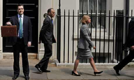 Chancellor of the Exchequer George Osborne poses with the red box as his team walk away