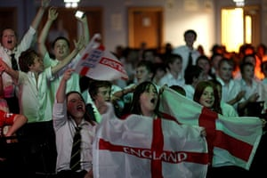 England fans: Wakefield, UK: Students celebrate the first goal at Horbury School