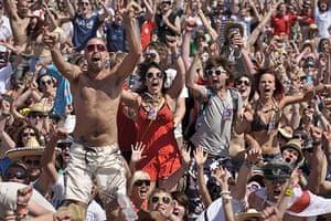 England fans: Somerset, UK: The crowd at Glastonbury Festival go wild as England score