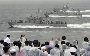 Korean War anniversary: Sailors salute as they sail past on South Korean naval patrol ships