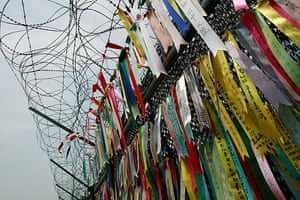 Korean War anniversary: Pro-unification messages hang on the barbed wire at the Imjingak Pavilion