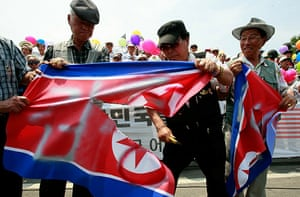 Korean War anniversary: South Korean activists tear North Korean flags