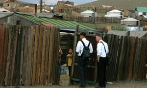 Mormon missionaries make a house visit in Ulaan Baator, Mongolia, 8 July 2005.