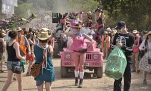 Glastonbury: performers from Trash City make their way through Worthy Farm