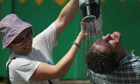 Glastonbury festivalgoers try to cool off in the hot weather