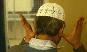 Muslim prisoner saying prayers in prison