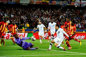 Knockout stages day 1: Ghana goalkeeper Richard Kingston makes a save from Benny Feilhaber