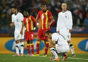 Knockout stages day 1: Landon Donovan composes himself before taking a penalty