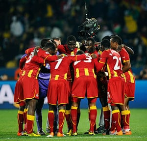 Knockout stages day 1: The Ghana team huddle at half-time