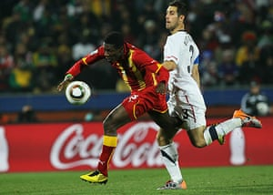 Knockout stages day 1: Asamoah Gyan chases the ball