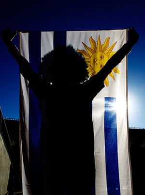 Knockout stages day 1: Uruguay fan with flag