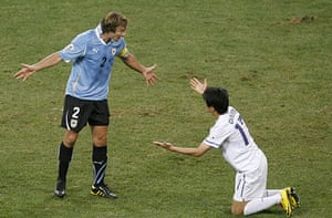 Knockout stages day 1: Uruguay's Diego Lugano, left, argues with South Korea's Chung Yong Lee