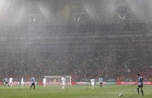 Knockout stages day 1: Heavy rain at the Uruguay v South Korea match