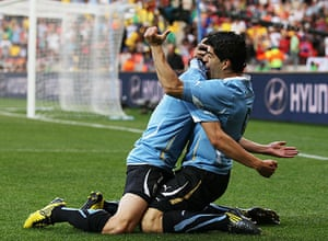 Knockout stages day 1: Luis Suarez celebrates scoring his first goal