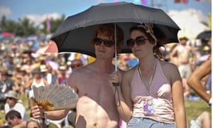 Two festival-goers shelter from the sun.