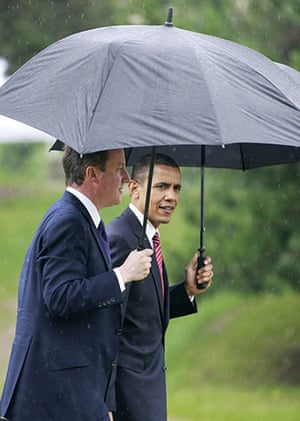 David Cameron at G8: President Barack Obama and Prime Minister David Cameron walk in the rain