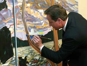 David Cameron at G8: Prime Minister David Cameron adds a few paint strokes to a painting