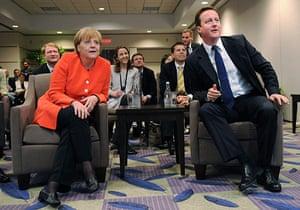 David Cameron at G8: David Cameron and Angela Merkel watch the World Cup football match