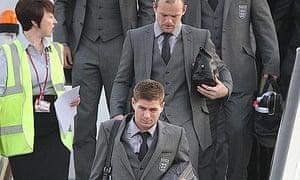 Steven Gerrard and Wayne Rooney arrive at Heathrow