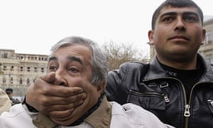 24 hours in pictures: A plain-clothes policeman detains opposition activist in  Baku, Azerbaijan