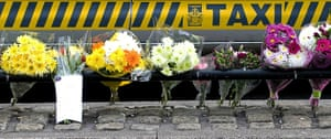 Cumbria shootings: Floral tributes at a taxi rank on Duke Street in Whitehaven