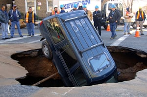 Sinkholes: 2006, New York, US: A Ford Explorer sits nose-first inside a sinkhole