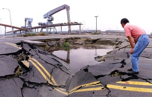 Sinkholes: 1999, Taichung, Taiwan: A man looks at a quake-opened sinkhole
