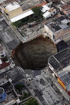 Sinkholes: 2010, Guatemala City, Guatemala: A sinkhole covers a street intersection