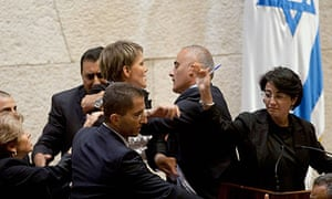 Haneen Zuabi attempts to speak at Israeli Knesset as Anastassia Michaeli is escorted off the podium