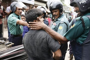 Dhaka protests: A Bangladeshi police slaps the face of a suspected protester
