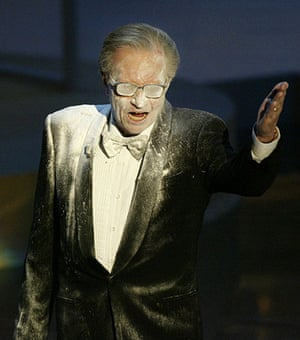 Larry King retires: 2002: Larry King doused with powder during the 54th annual Emmy Awards