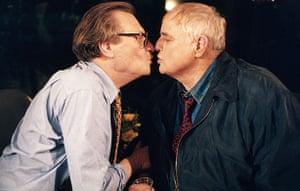 Larry King retires: 1994: Marlon Brando plants kiss on talk show host Larry King