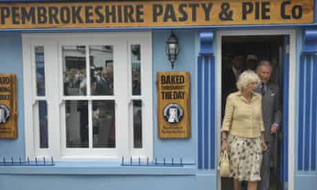 The Prince of Wales and the Duchess of Cornwall visit a shop in Tenby, where they are on holiday