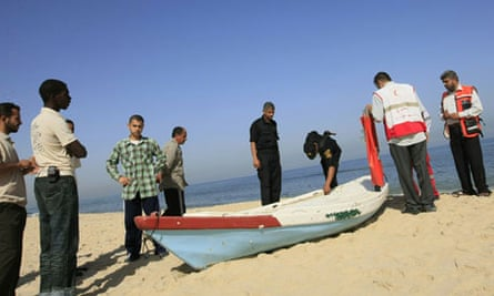 Police inspect a boat on the beach in Gaza