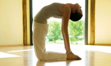 A woman in yoga camel pose