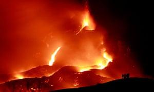Visitors gaze on the intense heat of the Pacaya volcano