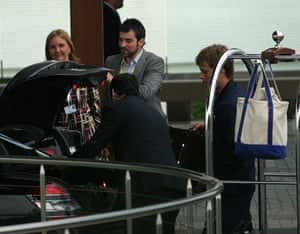 Bilderberg attendees: Who's this Bilderbabe, hiding coyly behind the boot of her Merc?