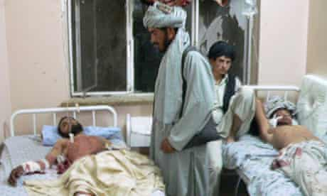 Two of the wounded in hospital in Kandahar after a wedding was hit by an explosion.