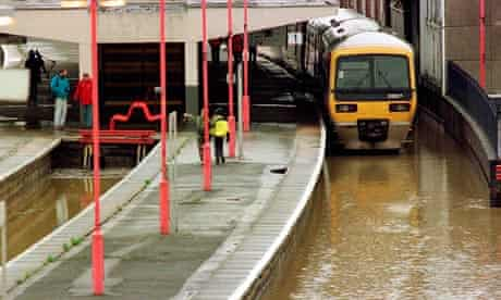 Train standing at waterlogged station