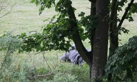 Raoul Moat lies face down in a field near Rothbury during negotiations with police