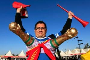 sport: A Spanish fan wears two plaster replicas