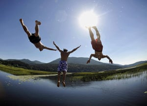 24 hours in pictures: Slovenia: Boys jump into lake Cerknica