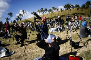 24 hours in pictures: Easter Island: Tourists watch the solar eclipse