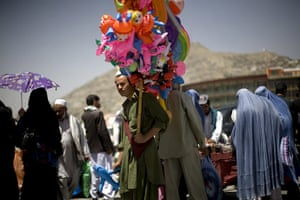 24 hours in pictures: Kabul, Afghanistan: A street vendor waits for customers